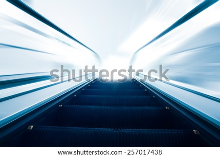 Empty escalator going up with motion blur - stock photo