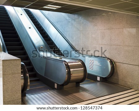 Empty escalator stairs in the Terminal ( underground Mall ) - stock photo