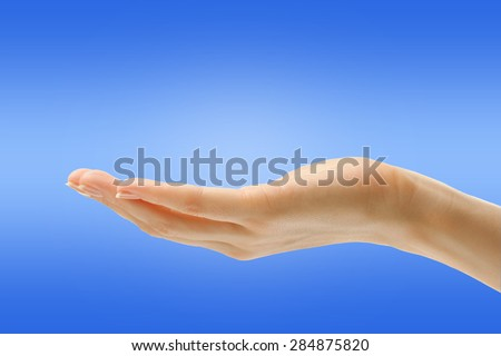 Empty female hand in closeup holding gesture
