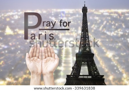 Empty female open human hands prayer with abstract Background top view of Paris in lights and bokeh. Concept for pray for Paris, Thanksgiving, Christmas, Forgiveness. euro 2016  - stock photo