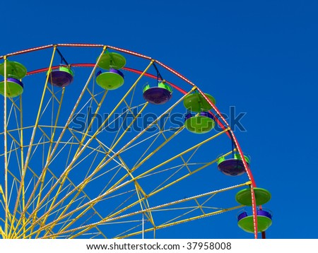 empty Ferris wheel with blue sky in the background