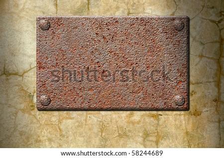 Empty ferruginous signboard on a concrete wall - stock photo