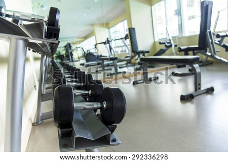 Empty fitness center with different training equipment