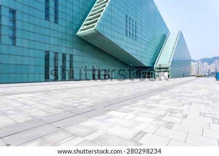 Empty floor in front of modern building - stock photo