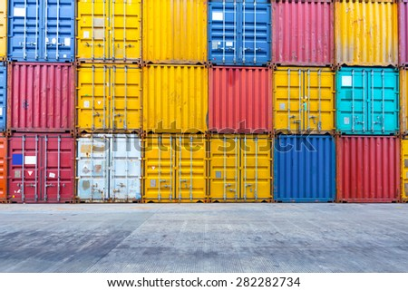 Empty floor with stacks of containers  - stock photo