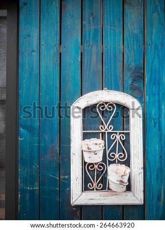 Empty flower pot abandoned on blue wood plank wall - stock photo