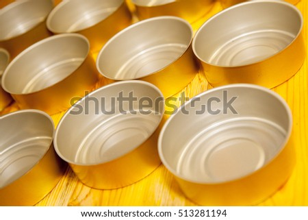 empty food tins prepared for filling