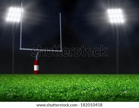 Empty Football Field with Spotlights - stock photo