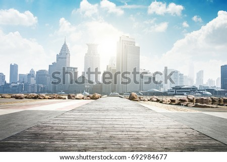 Empty footpath with modern skyline and buildings.