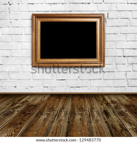 Empty frame in grunge room - stock photo