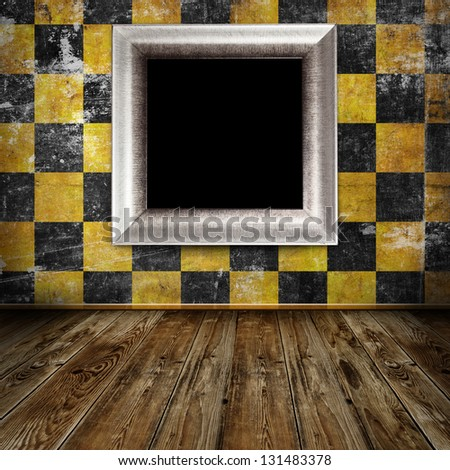 Empty frame in orange grunge room - stock photo