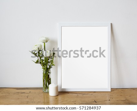 empty frame mockup for design presentation bouquet of flowers ranunculus and white candle on a - Empty Picture Frame