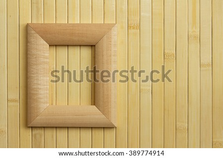 Empty frame on a wooden surface. Wooden frame on the wall. Wood background for design. Blank wood background. - stock photo