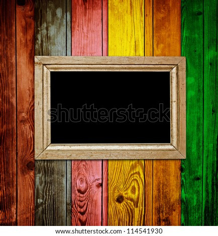 Empty frame on colorful wood background - stock photo
