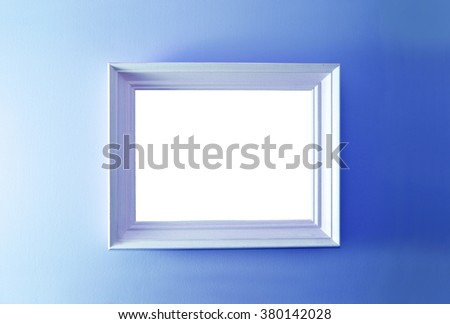 Empty frame on the blue wall. Free copy space. - stock photo