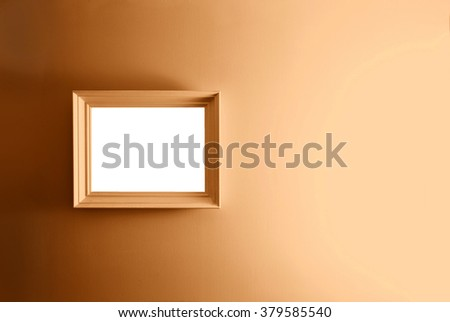 Empty frame on the brown wall. Free copy space. - stock photo
