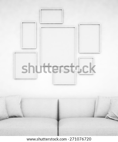 Empty frames in a room with a sofa - stock photo