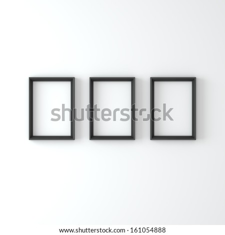 Empty frames on a white wall - stock photo