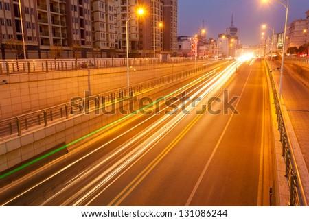 Empty freeway at night - stock photo