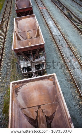 Empty freight wagons passing by. Photographed from above - stock photo