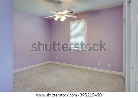 empty girls bedroom with lavender walls and no furniture