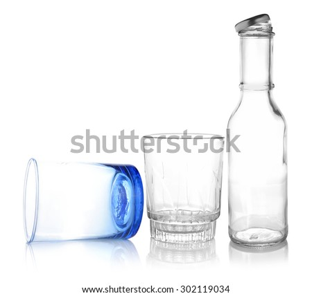 Empty glass and bottle isolated on white background. - stock photo