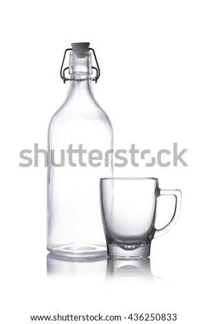 Empty glass and bottles isolate on white background