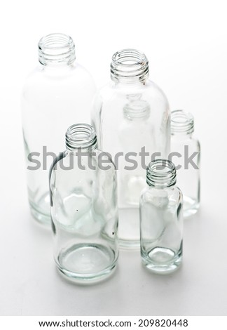 empty glass bottle selective focus - stock photo