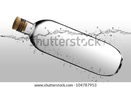 empty Glass bottle with cork floating.