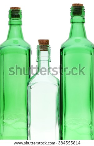 Empty glass bottle with cork stopper isolated on white background