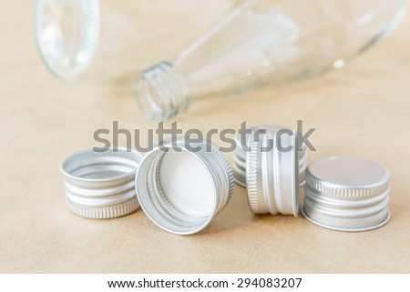 Empty glass bottles brown background.