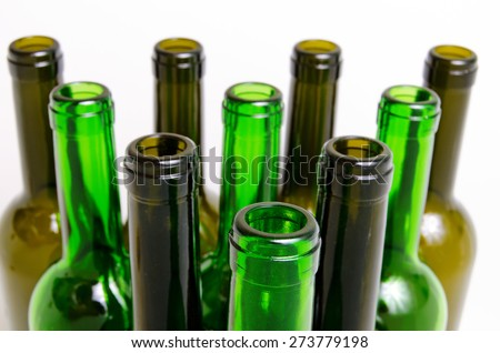 Empty glass bottles for industrial disposal.