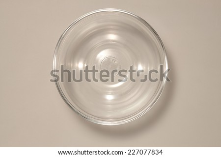 Empty Glass bowl isolated on Grey Background with real Shadow. Top View - stock photo