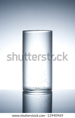 Empty glass close up on a mirror surface