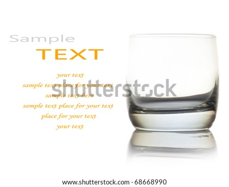 Empty glass for whiskey over white background