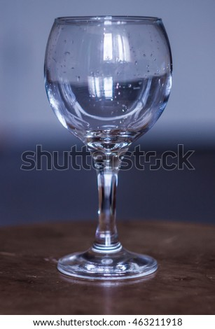 Empty glass. Isolated on a wooden background.