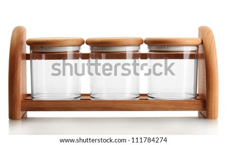 empty glass jars for spices on wooden shelf isolated on white - stock photo