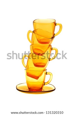 Empty glass mugs over white background.