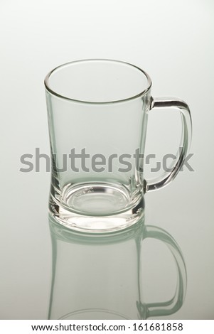 empty glass of beer on a glass table - stock photo