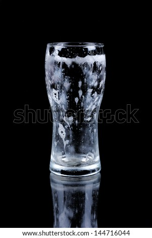 Empty glass of drained fresh beer - stock photo