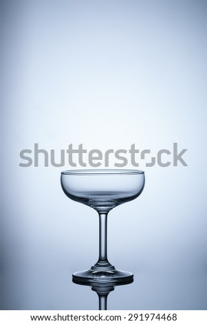 empty glass on blue light background