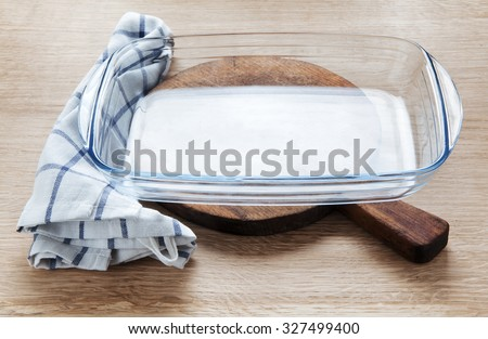 empty glass pan on wooden table - stock photo