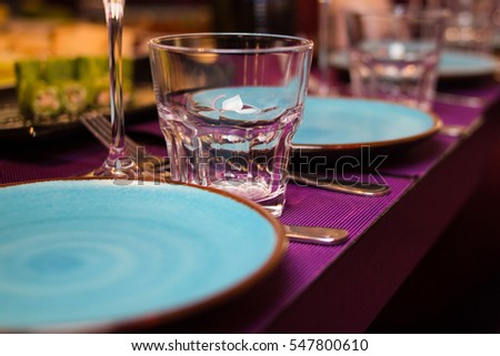 empty glass,plate with napkin-catering service in restaurant