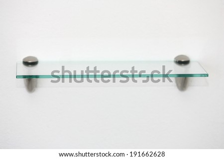 Empty glass shelf holder in modern style restroom nice and useful to putting your stuff and ideas into it - stock photo