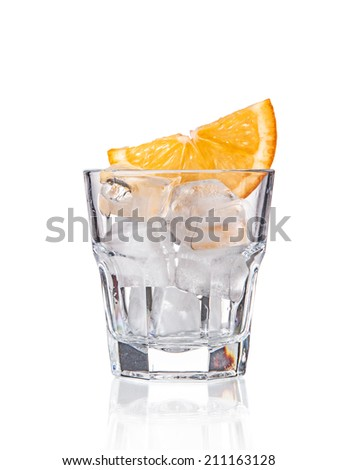 Empty glass whit ice and orange slice - stock photo