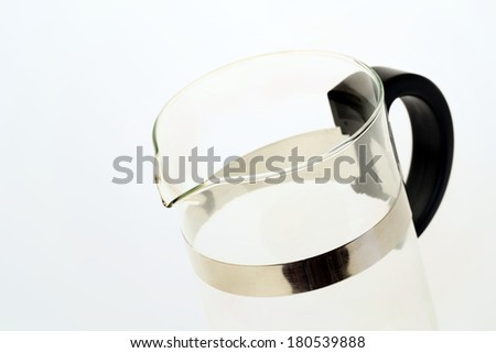Empty glass with black handle on a blue background