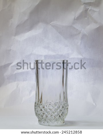 Empty glass with vintage look background - stock photo