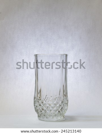 Empty glass with vintage look background. - stock photo