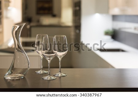 Empty Glasses and Wine Carafe in Stylish Modern Kitchen