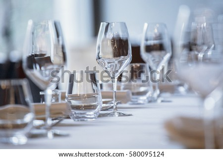 Empty glasses in restaurant. Cutlery on the table in a restaurant table setting, knife, fork, spoon, interior. Selective soft focus on Wine glass on dining table in restaurant.